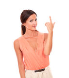 Charming woman in elegant shirt pointing up Royalty Free Stock Photo