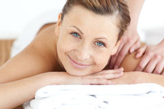 Charming woman enjoying a back massage Stock Photo