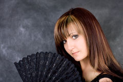 Charming woman with  fan Stock Image