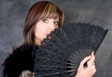 Charming woman with fan Stock Photos