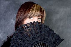 Charming woman with fan royalty free stock image