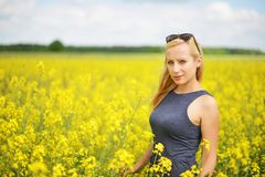 Charming woman. At  field of canola Stock Photo