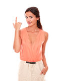 Charming woman with fingers gesturing shooting Royalty Free Stock Photos
