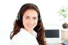 Charming woman with headset working in call center Stock Images