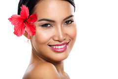 Charming woman with hibiscus flower Stock Photos