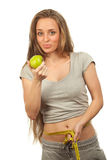 Charming woman holding apple Royalty Free Stock Photos