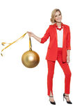 Charming Woman Holding Big Golden Tree Ball. Happy New Year. Royalty Free Stock Image