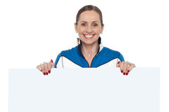 Charming woman holding blank whiteboard Stock Image