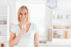 Charming woman holding glass filled Stock Photography