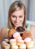 Charming woman holding a plate of cakes Stock Images