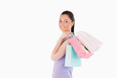 Charming woman holding shopping bags Stock Photo