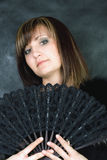 Charming woman with italian fan Royalty Free Stock Images