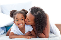 Charming woman kissing her daughte Royalty Free Stock Image