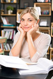 Charming woman in the library reading room Stock Photography