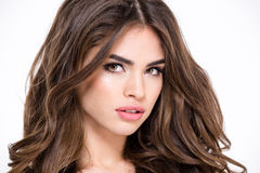 Charming woman with long hair looking at camera Royalty Free Stock Image