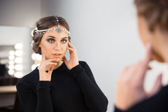Charming woman looking at her reflection in the mirror Royalty Free Stock Photo
