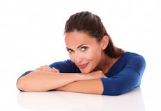 Charming woman looking at you with arms crossed Stock Images