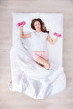 Charming woman lying in bed Stock Image