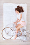 Charming woman lying in bed stock photography