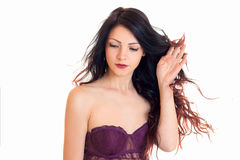 Charming woman in magenta peignoir with closed eyes Royalty Free Stock Image