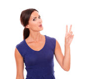 Charming woman making a victory sign with fingers Stock Image