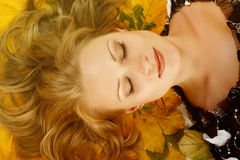 Charming woman with maple leaves Royalty Free Stock Images