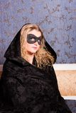 Charming   woman in a mask Stock Photo