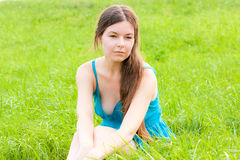 Charming  woman on nature. Charming young woman sitting on green grass Stock Images
