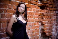 Charming woman near brick wall Stock Photo