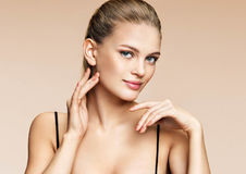 Charming woman with perfect skin. Photo of young woman on beige background. Beauty & Skin care concept Stock Images