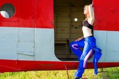 Charming woman pilot enjoying the sunlight Royalty Free Stock Photography