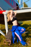 Charming woman pilot resting outdoors Royalty Free Stock Image