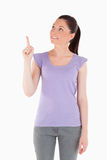 Charming woman pointing at a copy space Royalty Free Stock Images