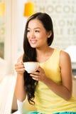 Charming woman. Portrait of charming Vietnamese woman drinking tea Stock Photo