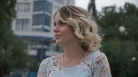Charming woman posing in park stock footage