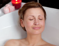 Charming woman relaxing in a bath Stock Image