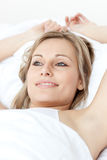 Charming woman relaxing  lying on a bed Royalty Free Stock Images