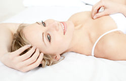 Charming woman relaxing lying on her bed Royalty Free Stock Photo