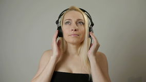 Charming woman 40s listening to music wearing headphones. Charming woman DJ 40s listening to music wearing headphones stock footage
