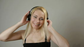 Charming woman 40s listening to music wearing headphones. Charming woman DJ 40s listening to music wearing headphones stock video footage
