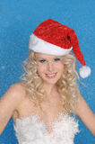 Charming woman in Santa hat and snow Stock Photos