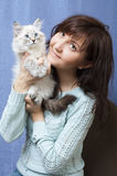 Charming woman and sibirsky nevsky kitten Royalty Free Stock Photos
