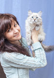 Charming woman and sibirsky nevsky kitten Royalty Free Stock Photography