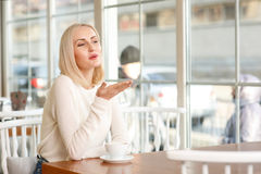 Charming woman sitting in the cafe Stock Image