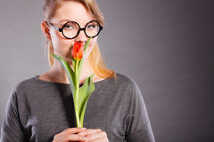 Charming woman smelling flower feel peace. Stock Photo