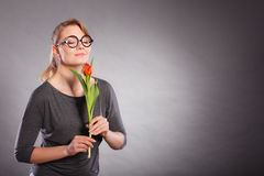 Charming woman smelling flower feel peace. Stock Image