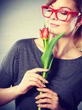 Charming woman smelling flower feel peace. Royalty Free Stock Photo