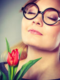 Charming woman smelling flower feel peace. Royalty Free Stock Images
