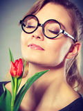 Charming woman smelling flower feel peace. Royalty Free Stock Image