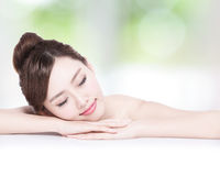 Charming woman Smile enjoy spa. Charming woman face Smile enjoy spa and massage while lying with green background, asian girl Stock Image